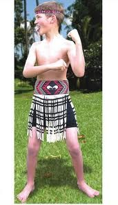 The costume features a boy's style short piupiu – the flax skirt worn during Kapa Haka and as traditional Maori dress, and a tipare (head band)