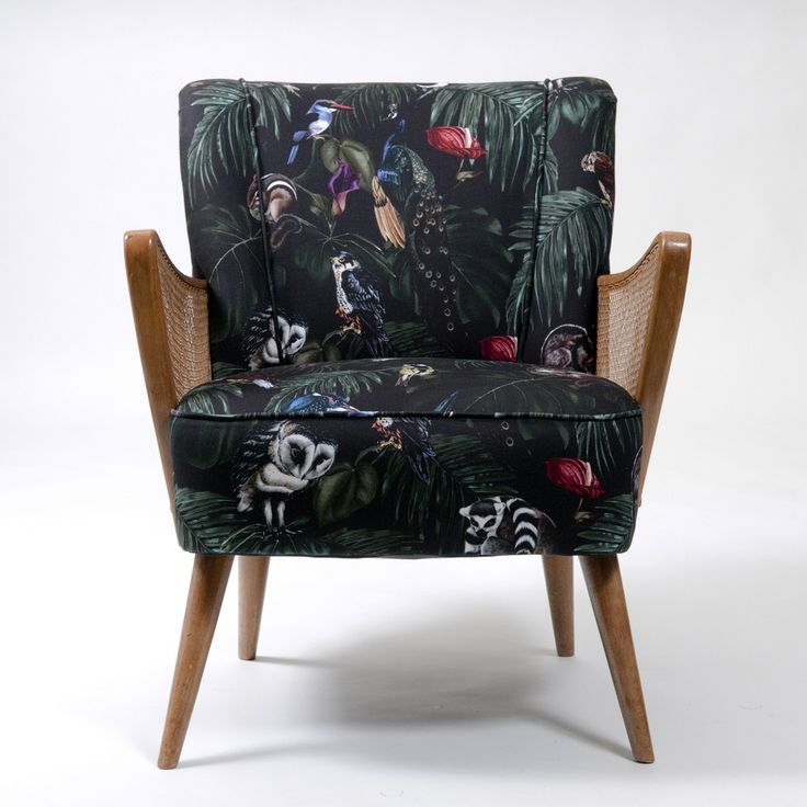 Retro Scandinavian Chair upholstered in Amazonia Dark Fabric by Witch and Watchman in Velvet and Cotton Featuring tropical palm leaves, cheese plants, fern leaves, peacocks, lemurs, owls and other birds and animals!