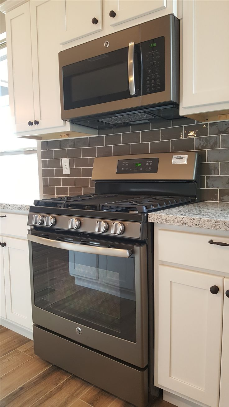 GE gas range and OTR microwave in slate finish