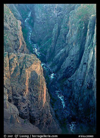View down steep rock walls and narrow chasm. Black Canyon of the Gunnison National Park, Colorado