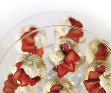 The addition of cream cheese and butter to the whipped cream frosting make the Strawberry Shortcake #Cupcakes easy to pick up and eat. #AnnaOlson