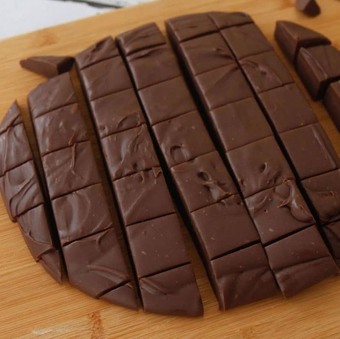 Fudge is a type of sugar candy that is made by mixing sugar, butter and milk, heating it to the soft-ball stage at 240 °F (116 °C), and then beating the mixture while it cools