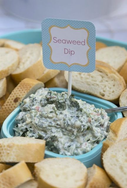 "Seaweed dip (artichoke dip) with blue corn tortilla chip ""shark fins"""