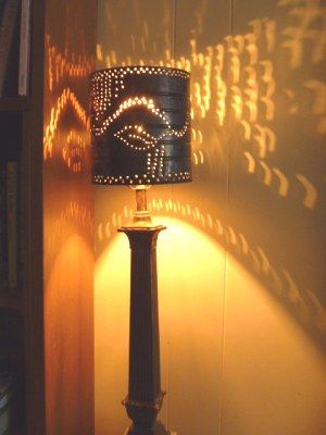 The effect of punched tin lamp shades when lit from within is magical.  The way the light sprinkles out onto any surface will charm and delight you.