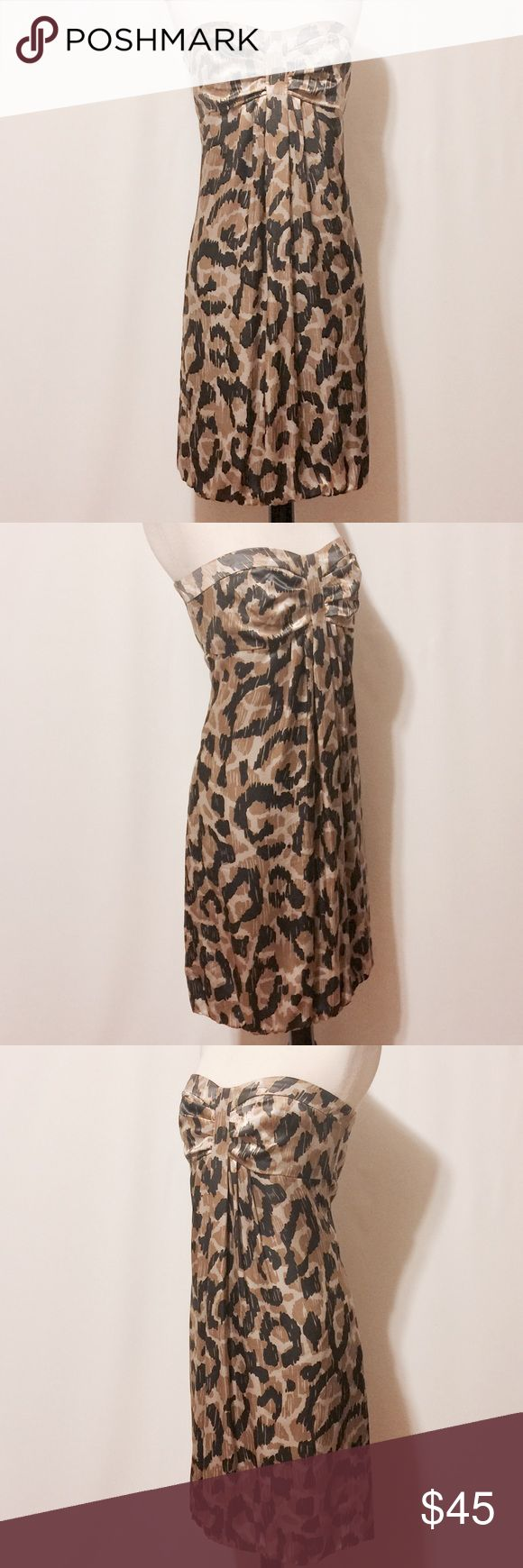"""💫 Donna Ricco Silk Strapless Animal Print Dress Strapless beauty! Tan, cream, gold and charcoal animal print. Pleated framed bodice, bonded and interior elastic to stay in place. Fully lined, center back invisible zipper closure. 100% Silk 100% Polyester lining Dry Clean Only 36"""" Bust 34"""" Waist 41"""" Hips 46"""" Sweep 30""""Overall length Donna Ricco Dresses Strapless"""