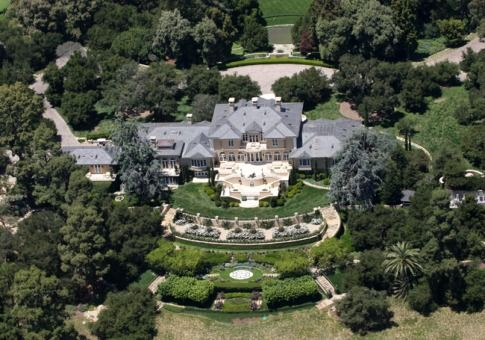 Promised Land, Montecito, Calif.  Owner: Oprah Winfrey, worth $2.7 billion  Purchase Price: $50 million in 2001  The media queen's 23,000-square-foot Georgian-style manse sits on more than 40 acres, boasting a tea house, more than 600 rose bushes and an upscale outhouse.