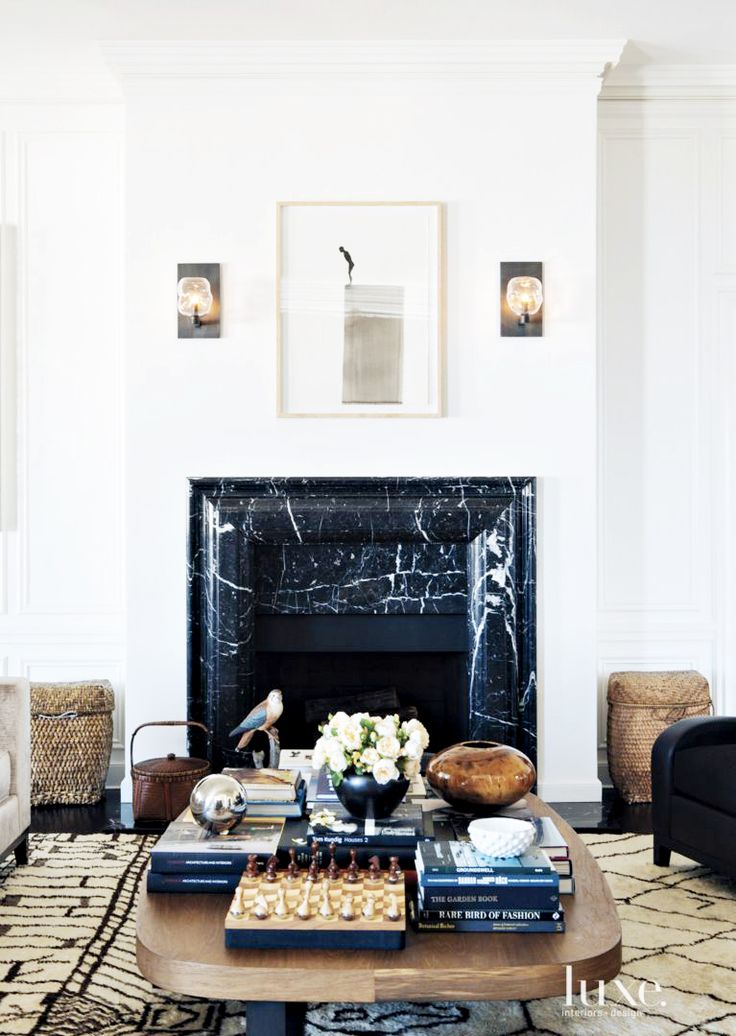 Marble fireplace in feminine living room, artwork and wall sconces // coffee table inspiration, roses