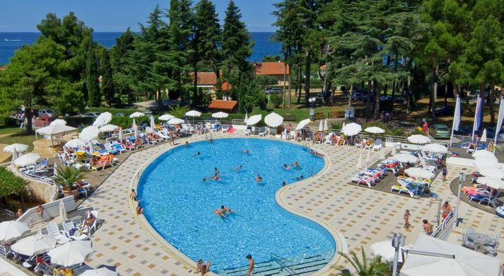Valamar Pinia Hotel Poreč This seafront hotel offers an outdoor pool with seawater. Porec's historical centre is a 10-minute walk away along the beach. Free WiFi is available in all areas.  Air conditioning and satellite TV are provided in all rooms at Valamar Pinia Hotel.