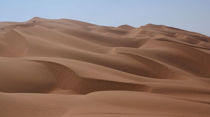 """The Rub' al Khali (Arabic: الربع الخالي ar-Rubʿ al-Ḫālī,[note 1] """"Empty Quarter"""") is the largest contiguous sand desert (erg) in the world,[1] encompassing most of the southern third of the Arabian Peninsula. The desert covers some 650,000 square kilometres (250,000 sq mi) including parts of Saudi Arabia, Oman, the United Arab Emirates, and Yemen.[2] It is part of the larger Arabian Desert."""
