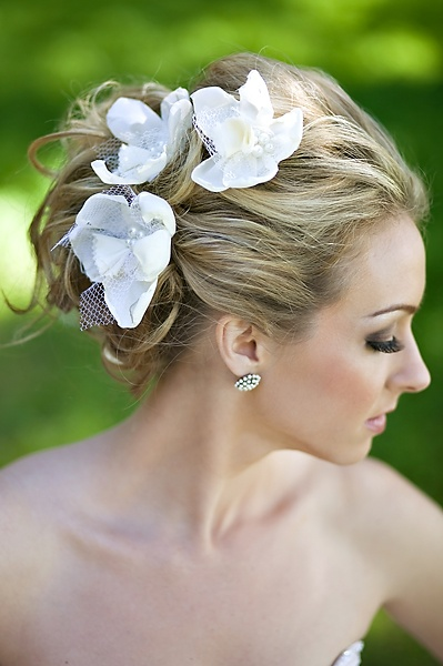 Have an elegant but simple Up do for your big day by just adding flowers.