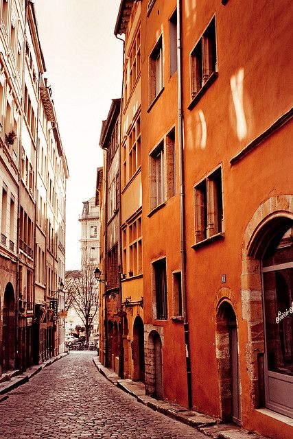 old city street with orange building