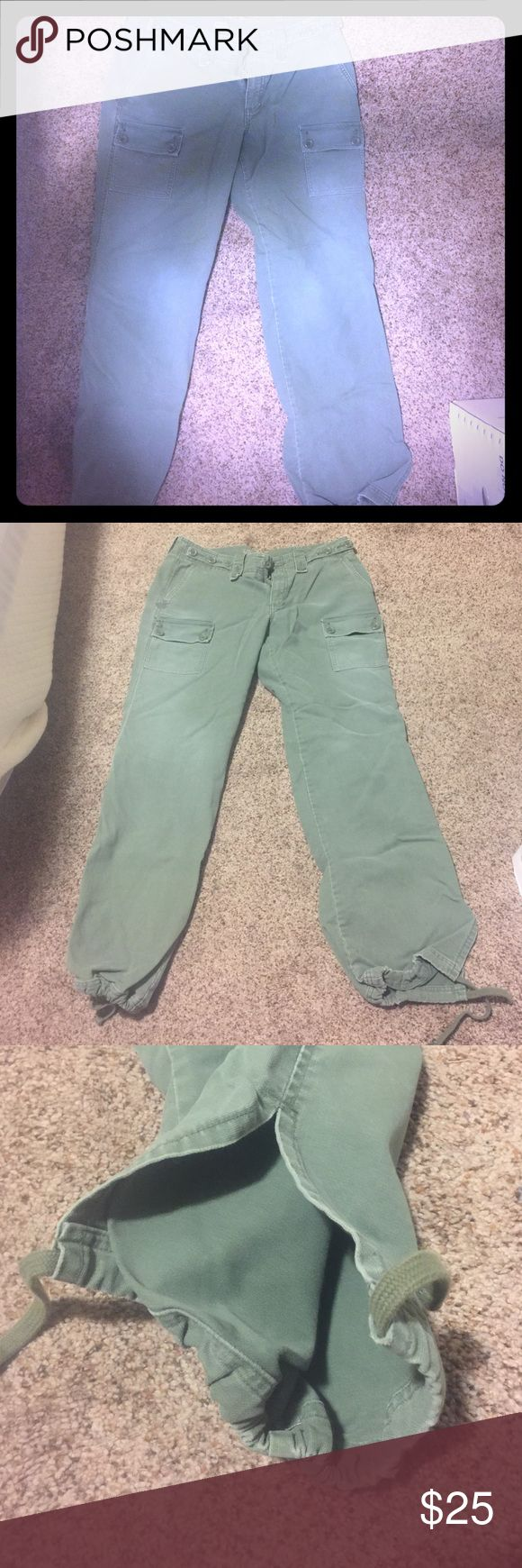 AE olive green canvas pants Size 12 American Eagle draw string legs zipper closure with button all functional. Worn twice. Thick canvas material. American Eagle Outfitters Pants Trousers