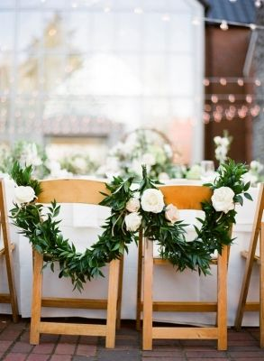 These chair details are so unique. Click the link and get some more idea from Enchanted Florist and book them for your wedding today. Image Credit: Enchanted Florist's Web Listing