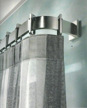 Love this- modern curtain pole. Moving away from uniformity of 'new build' home decor