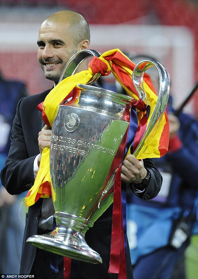 Pep Guardiola, the European Cup and the Catalan flag after Barcelona's triumph in 2011