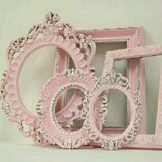 Pink picture frames decorate a shelf.