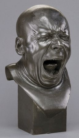 The artist is Franz Xaver Messerschmidt, that was actually born in 1736, so that is one of the things that are pretty interesting with this art work; the sculptures look so modern, but they are about 250 years old. http://en.wikipedia.org/wiki/Franz_Xaver_Messerschmidt