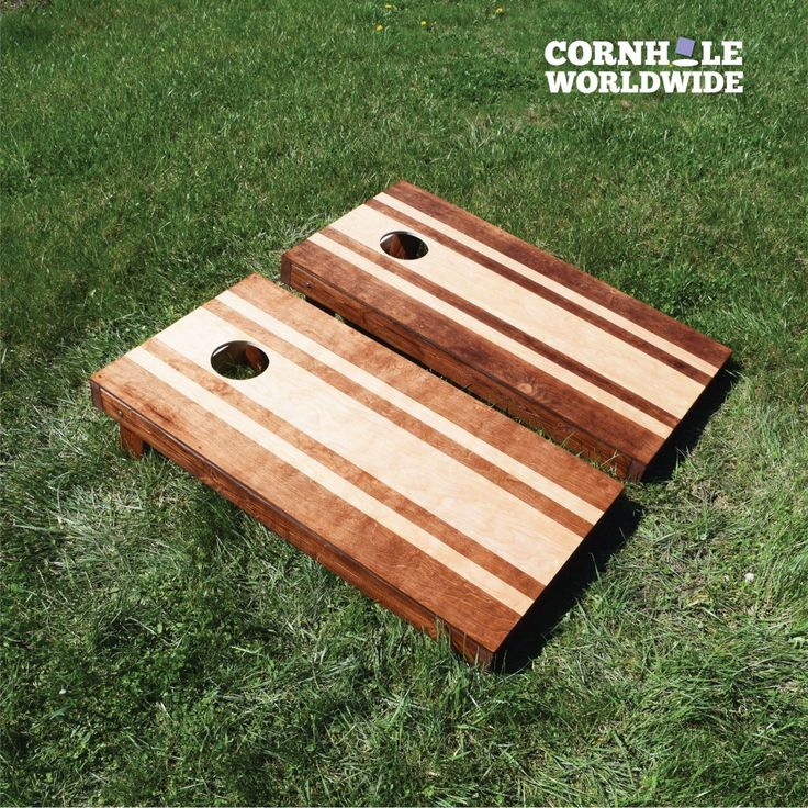 our stained striped hardwood game has some sleek lines for you to use as targets for - Cornhole Design Ideas