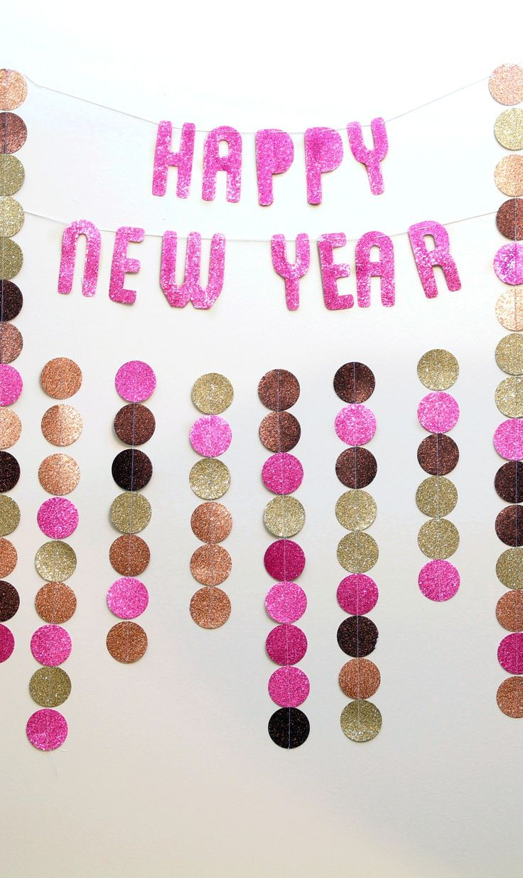 Create beautiful, lasting memories this New Year's Eve with our easy DIY photo backdrop. All you need are a few small tools and some glitter cardstock. Click in for step-by-step instructions.