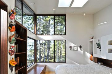 """Minimal window trim: The windows are Milgard metal with a site built wood liner. The 3/4"""" liner material extends beyond the face of the drywall and the drywall simply butts to it. This is mahogony, but we could do a hickory to match the floors (or similar color light wood...or stain cedar color, or...)"""