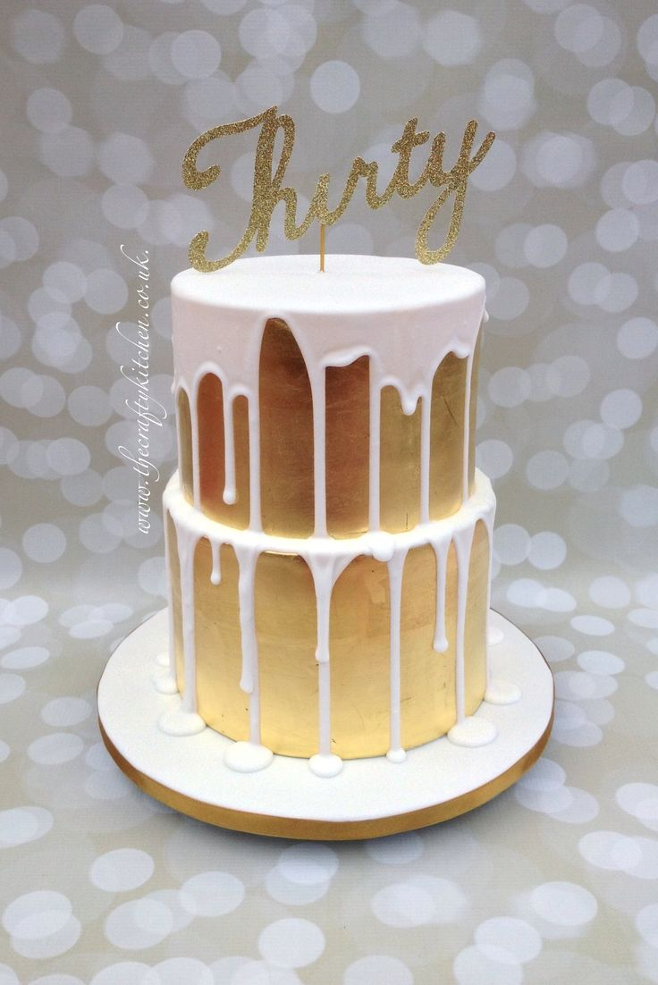 Gold Leaf & Drizzle Cake. This cake is covered in 24 carat edible gold leaf with royal icing drizzle. www.thecraftykitchen.co.uk
