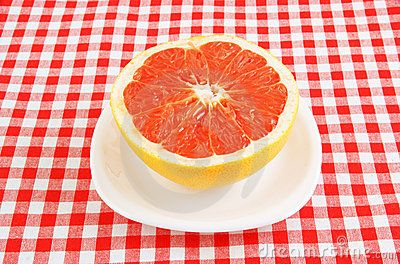 http://www.dreamstime.com/royalty-free-stock-photography-halved-red-grapefruit-tablecloth-image20585797