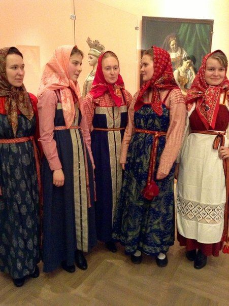 Exhibition of extant Russian folk costumes from various regions. Costumed ladies.