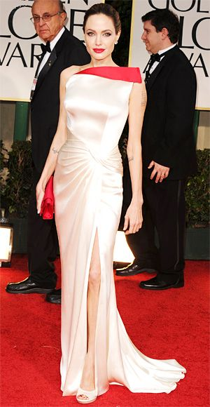Angelina Jolie in a gown by Atelier Versace. A custom pair of Lorraine Schwartz earrings finished off the look