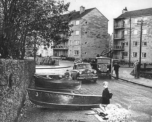 The Floods of October 1954. Cars and lorries were a regular sight on the streets of Glasgow, even in 1954, but boats were much less common. This was the scene in Glenspean Street in 1954 after the area was hit by floods. The flooding affected the whole of the south side after heavy rain battered Glasgow throughout autumn and into winter. The boats were used by workmen trying to minimize damage to the area's newly built flats and by local children pretending to be pirates.