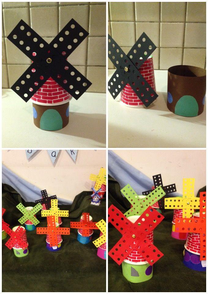 Molen gemaakt van omgekeerd papieren koffiebeker. Voorbeeld voor groep 1. Voorgeknipte stukjes muurpapier. Ramen van plakcirkels. Zelf deur laten knippen. Wieken van borduurkarton.