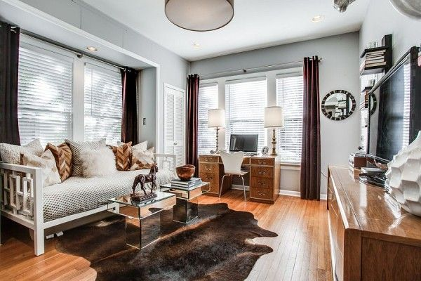 Guestroom, TV room and home office rolled into one with panache