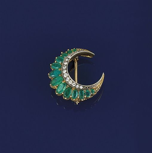 A LATE 19TH CENTURY EMERALD AND DIAMOND CRESCENT BROOCH Composed of a graduated line of oval emeralds with later single-cut diamond line edging, circa 1890