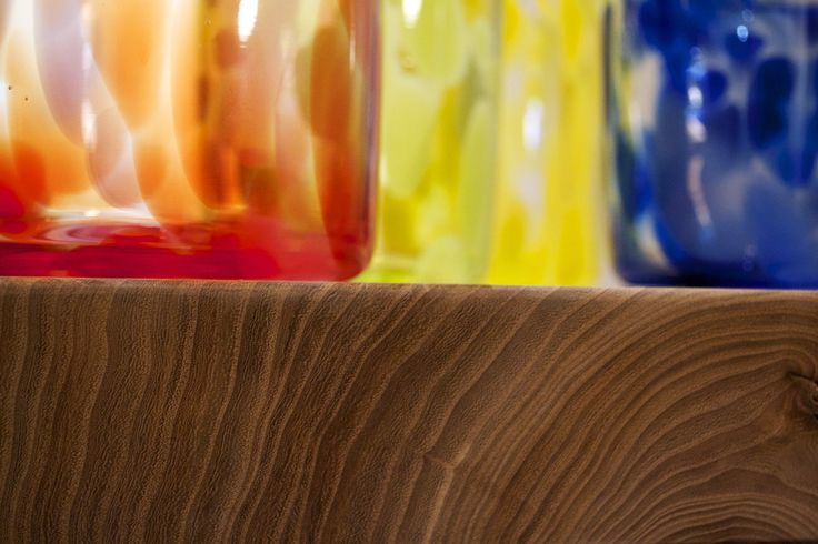 Glass meets Wood detail Elm slab coffee table by eacdesign.com.au  and colourful blown glass canisters by emiliepatteson.com.au
