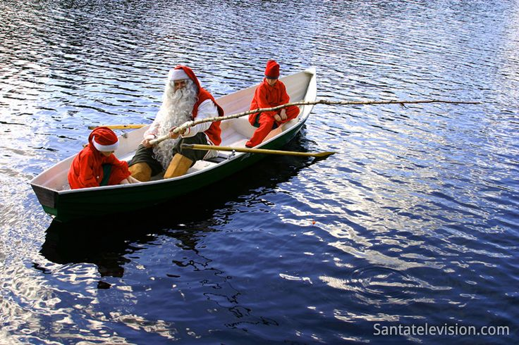 Santa Claus and elves fishing in Lapland