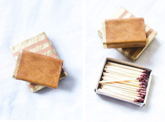 Tändsticksaskar i läder och guld av Sandra på Atilio / Metro