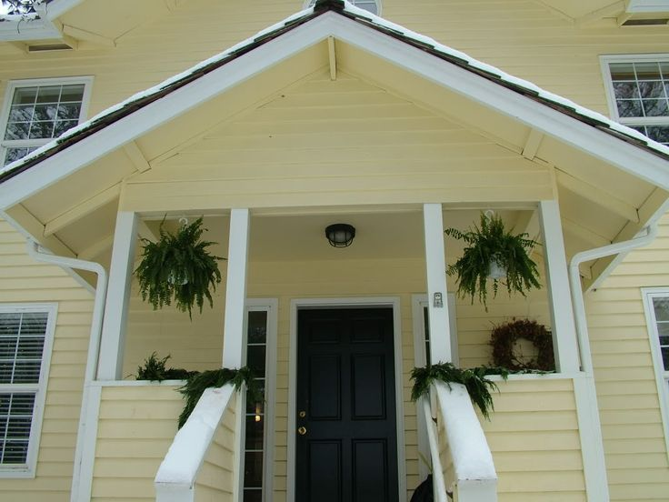 yellow siding and front door colors   ... my old house, I love the black door. New home has black door as well