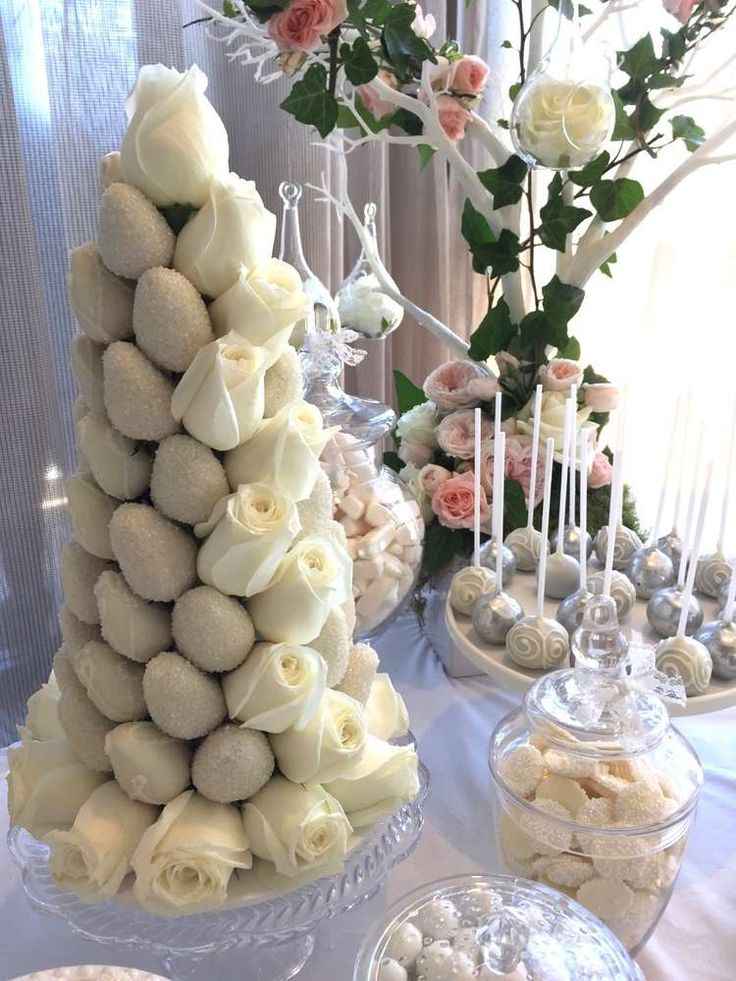 Fantastic strawberry tower at a white wedding party! See more party planning ideas at CatchMyParty.com!