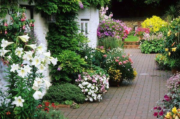 Patio de estilo campestre jardiner a jardines r sticos for Jardines rusticos campestres