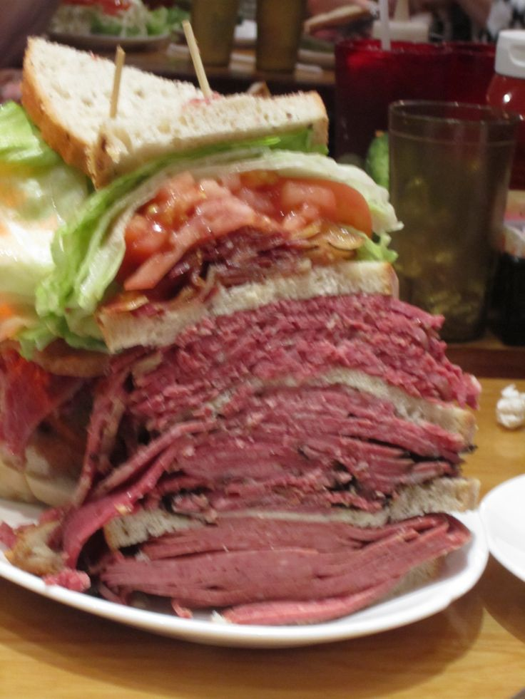 4/26/11 Carnegie Deli, NYC-The couple next to us got this monstrous sandwich-pastrami, corned beef, BLT, & one more meat.