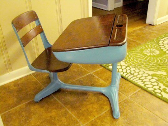 "Before & After: Clara's Two-Toned Desk   We see desks like this all the time at flea markets and usually dismiss them as too dowdy, but bright paint totally modernizes the look.  Ginger says she was inspired by the two-toned dresser that John and Sherry of Young House Love re-did for their own Clara. She tells us that she ""sanded and restained the wood with Minwax stain in English Chestnut. The metal bottom was spray-painted with Valspar in Mediterranean."""