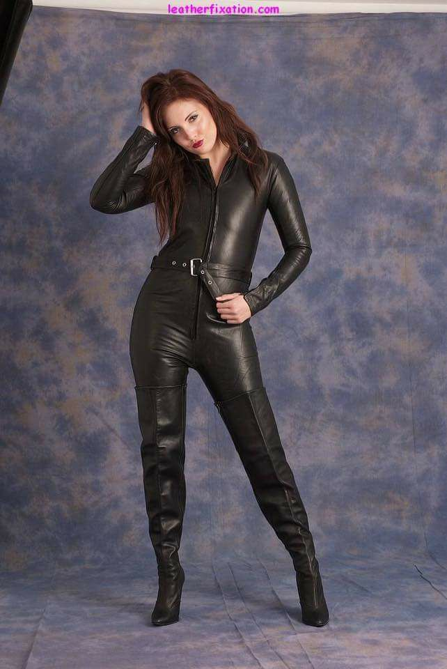 2342ce79e9f Belted black leather jumpsuit and thigh boots