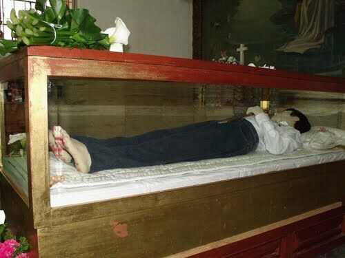 "This is the incorrupt body of Blessed Jose Luis Sanchez del Rio, martyered during the Cristero War in Mexico in 1928 at the age 14. 84 years later his body is free from any sign of decomposition. He was among 90,000 Catholics that were killed for their faith during this war. His last words were ""Que Viva Cristo Rey!"""