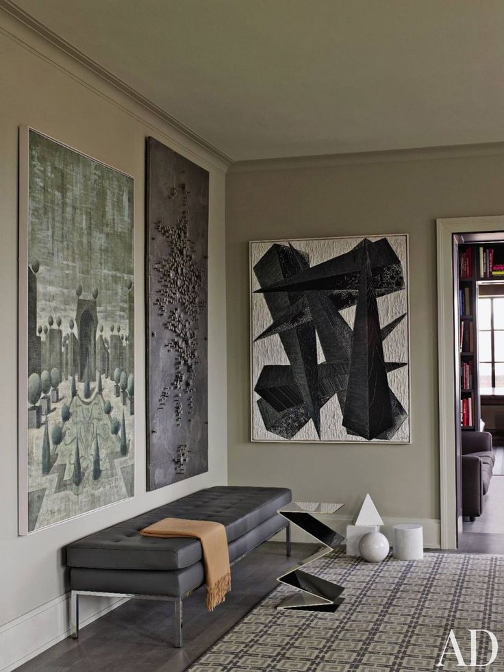 A vintage Knoll bench sits in a corner of a Manhattan living room, beneath a fanciful painting of a formal parterre, and a 1970s metal-studded work from Galerie Camoin Demachy; the abstract canvas is '50s French.