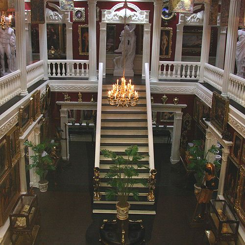 """Central staircase and displays in Ken Heseltine's """"My Private Museum"""" roombox in 1:12 scale."""
