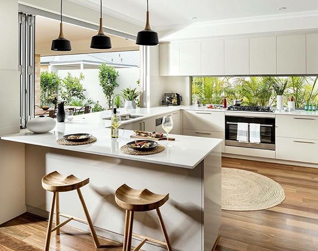 i like the natural look of the kitchen cabinets. prefer white bench. love the floor colour.