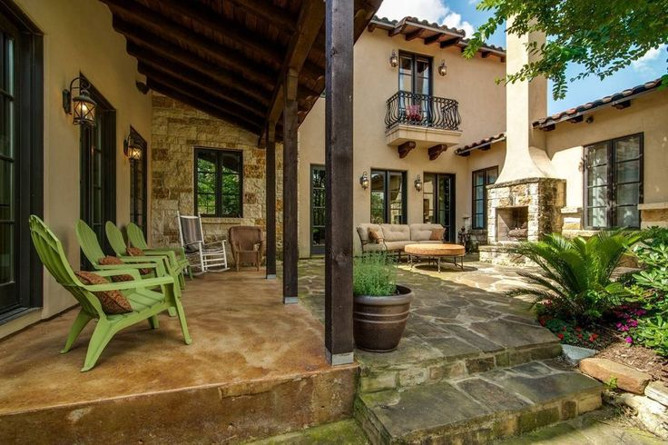 Mediterranean Patio with Raised beds, outdoor pizza oven, exterior stone floors, Western Sword Fern - Polystichum munitum