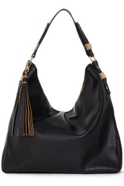 This large leather-look bag features a sturdy top carry handle, removable tassel charm, high-shine hardware, contrast lining and zip close interior pocket. Dimensions: 46cm (W) x 38cm (H) x 11.5cm (D)Fabric:Main: 100.0% Polyurethane.Wash care:Do Not CleanProduct code: 02281177 £32.00
