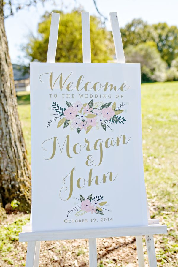The floral design and gold calligraphy of this welcome sign set the tone for the style of the wedding.   Just a Dream Photography