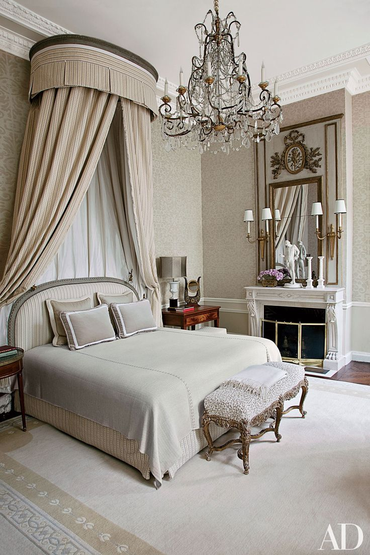 The bed in the master suite of a Paris home renovated by interior designer Jean-Louis Deniot is highlighted by an 18th-century corona and a Louis XV bench; the chandelier is 1880s Italian, and 1940s Jansen sconces flank the Louis XVI trumeau. | archdigest.com