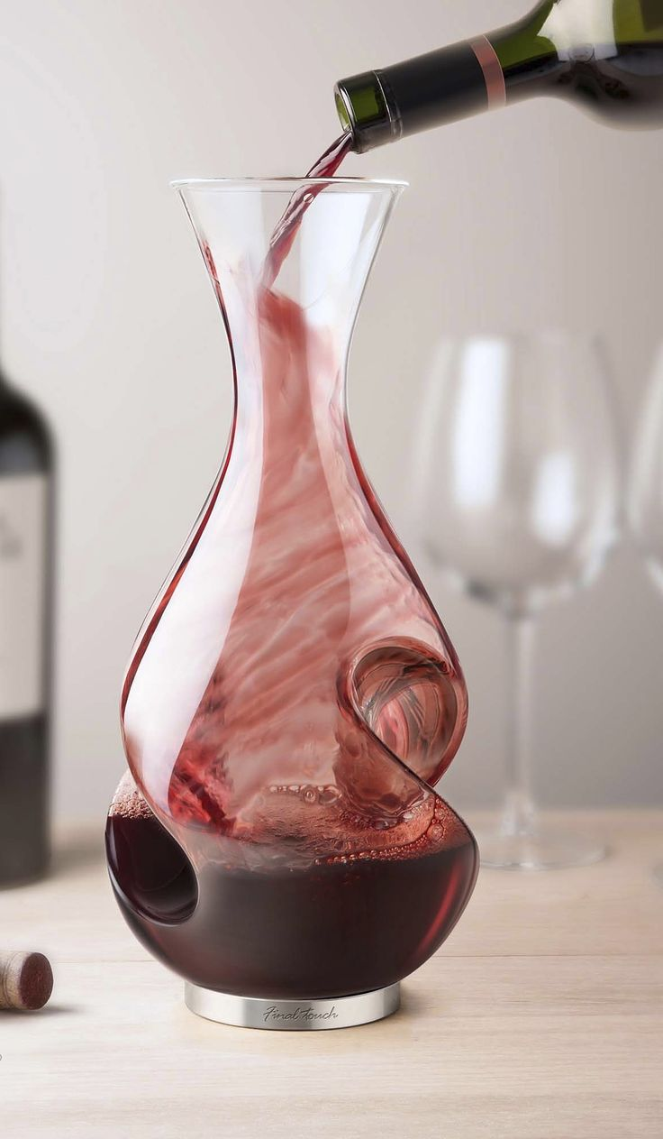 Enhance the flavor and the experience of drinking wine with the L'Grand Conundrum Wine Decanter and Aerator.